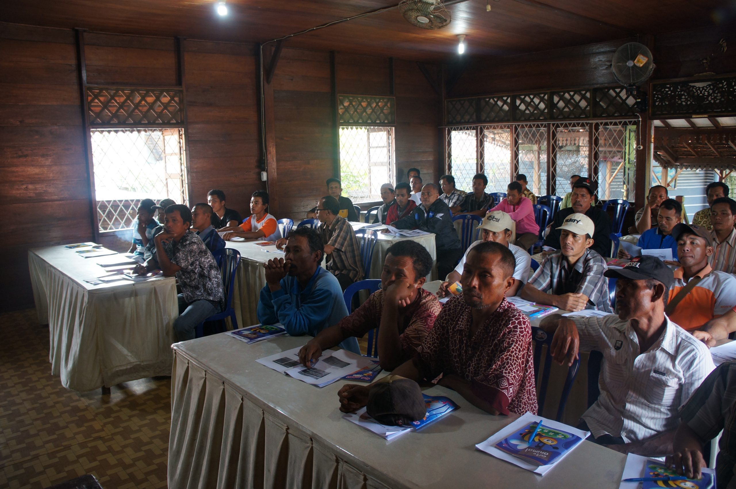 Farmers learning sustainable farming practices in Indonesia